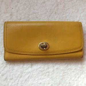 Coach sunflower turn lock yellow clutch wallet